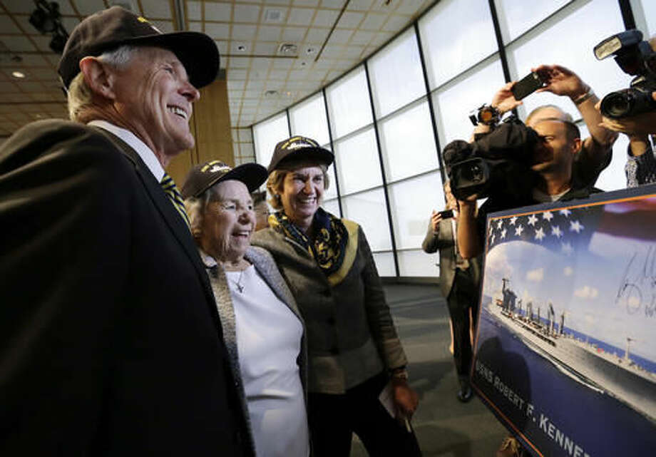 Navy Secretary Ray Mabus, left, Ethel Kennedy, widow of Sen. Robert F. Kennedy, and daughter Kathleen Kennedy Townsend smile as they look at a rendering of the Robert F. Kennedy Navy Ship named at the John F. Kennedy Presidential Library, Tuesday, Sept. 20, 2016, in Boston. The new ship's job will be to restock and refuel other ships already at sea. Ships in this class are being named in honor of civil and human rights heroes. (AP Photo/Elise Amendola)