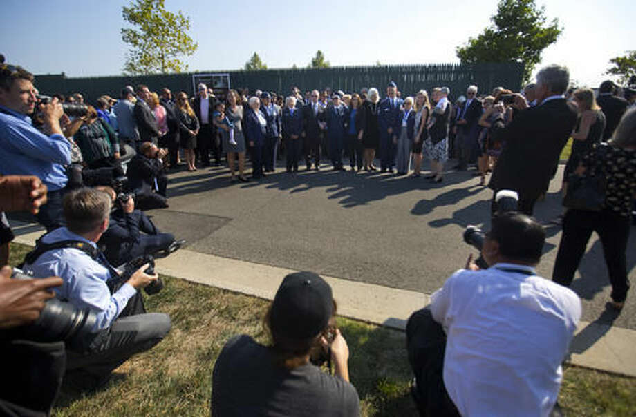 Members of the media watch as family and friends of World War II pilot Elaine Danforth Harmon arrive for the burial services, Wednesday, Sept. 7, 2016, at Arlington National Cemetery in Arlington, Va. It took an act of Congress, but Harmon was finally laid to rest on at Arlington National Cemetery, she died last year at age 95. She was one of the Women Airforce Service Pilots (WASP), a group of women who flew military aircraft on noncombat missions during World War II so that men were freed up for combat. (AP Photo/Pablo Martinez Monsivais)