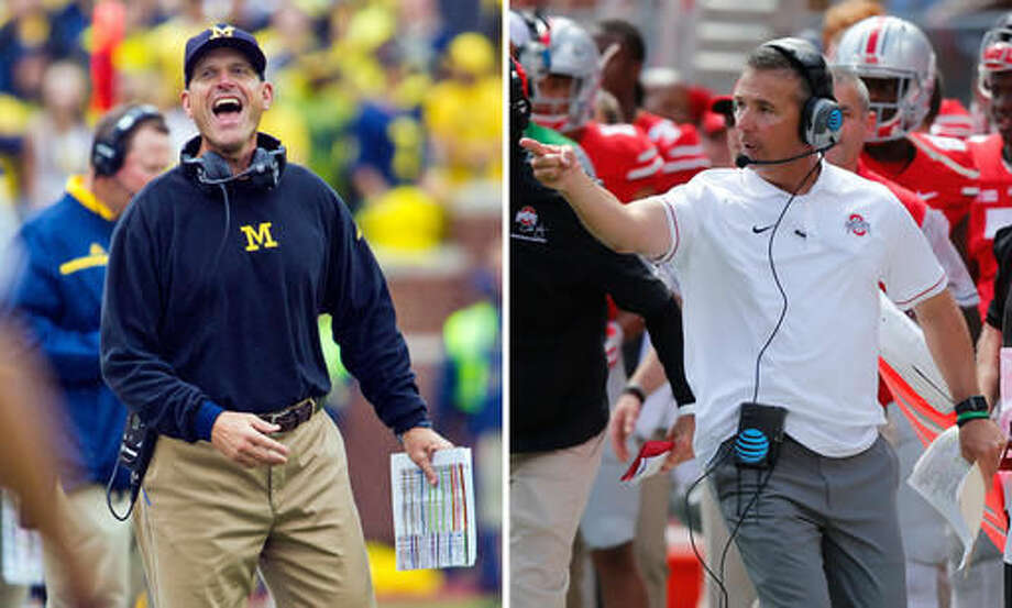 FILE - At left, in a Sept. 12, 2015, file photo, Michigan coach Jim Harbaugh laughs and reacts to an offical on the sideline during the team's NCAA college football game against Oregon State in Ann Arbor, Mich. At right, in a Sept. 3, 2016, file photo, Ohio State coach Urban Meyer shouts to his team during a game against Bowling Green in Columbus, Ohio. Elite programs often have trouble finding opponents willing to play them and will pay up to $1 million to lure a lower-tier team for the chance to host another lucrative home game. The result is usually absurdly-lopsided games like we saw the first weekend of the season, including Ohio State 77-10 over Bowling Green; and Michigan 66-3 over Hawaii. (AP Photos/File)