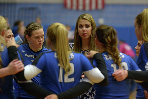 Barbers Hill head volleyball coach Lauren Leth, center, pumps up her team between sets against New Caney during their District 21-5A matchup at BHHS on Friday, Oct. 21, 2016.