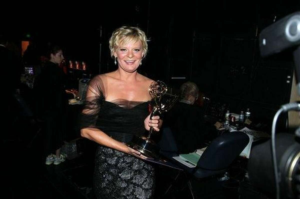 Martha Plimpton poses backstage with her award for outstanding guest actress in a drama series for playing Patti Nyholm on