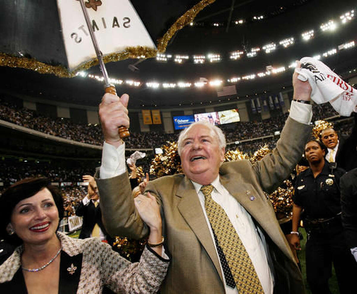 FILE - In this Sept. 25, 2006 file photo, New Orleans Saints owner Tom Benson dances with his wife Gayle Marie Benson after their football game with Atlanta Falcons at the newly re-opened Louisiana Superdome in New Orleans. The Saints won 23-3 The Superdome went from a candidate for demolition to a symbol of rebirth in the 13 months following Hurricane Katrina. (AP Photo/Alex Brandon, File)