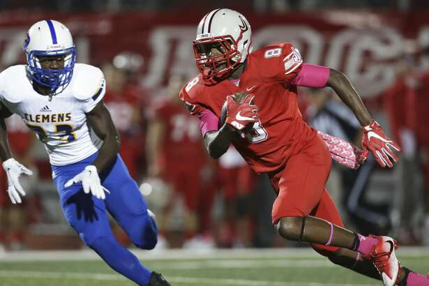 Rocket wide receiver Kevin Luster sprints downfield with Luke Kelley in pursuit as Judson hosts Clemens at Rutledge Stadium on October 21, 2016