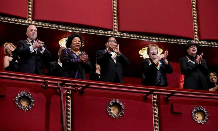 The recipients of the 2013 Kennedy Center Honors Billy Joel, from left, Martina Arroyo, Herbie Hancock, Shirley MacLaine and Carlos Santana applaud during the Kennedy Center Honors Gala at the Kennedy Center in Washington, on Sunday. (AP Photo/Manuel Balce Ceneta)