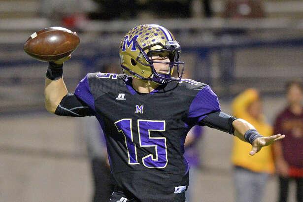 Midland High's Jackson Anuszkiewicz (15) throws against Amarillo Tascosa on Friday, Oct. 21, 2016, at Grande Communications Stadium. James Durbin/Reporter-Telegram