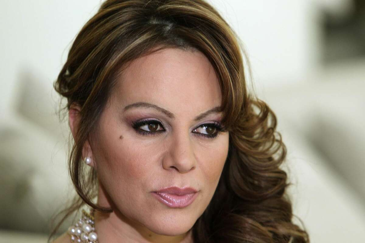 In this March 8, 2012 file photo, Mexican-American singer and reality TV star Jenni Rivera poses during an interview in Los Angeles. Las Vegas-based Starwood Management, the company that owns the luxury jet that crashed and killed Rivera on Dec. 9, is under investigation by the U.S. Drug Enforcement Administration, and the agency seized two of its planes earlier this year as part of the ongoing probe. (AP Photo/Reed Saxon, File)
