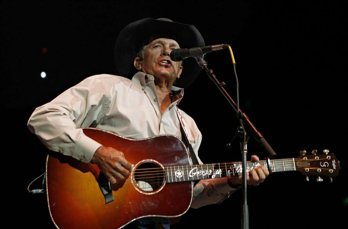 In this Oct. 17, 2011 file photo, George Strait performs during the Fire Relief, The Concert For Central Texas, at the Frank Erwin Center in Austin, Texas. The 60-year-old country music superstar on Wednesday, Sept. 26, 2012 announced that he'll embark on his final concert tour early next year. He made the announcement at a news conference at the Country Music Hall of Fame & Museum in Nashville, Tenn. (AP Photo/Erich Schlegel, File)