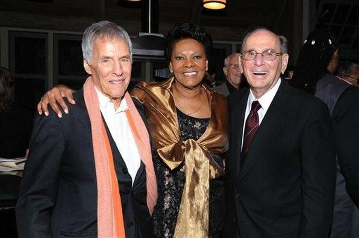 FILE - This Oct. 17, 2011 file photo shows legendary songwriters Bert Bacharach, left, and Hal David pose with singer Dionne Warwick at the