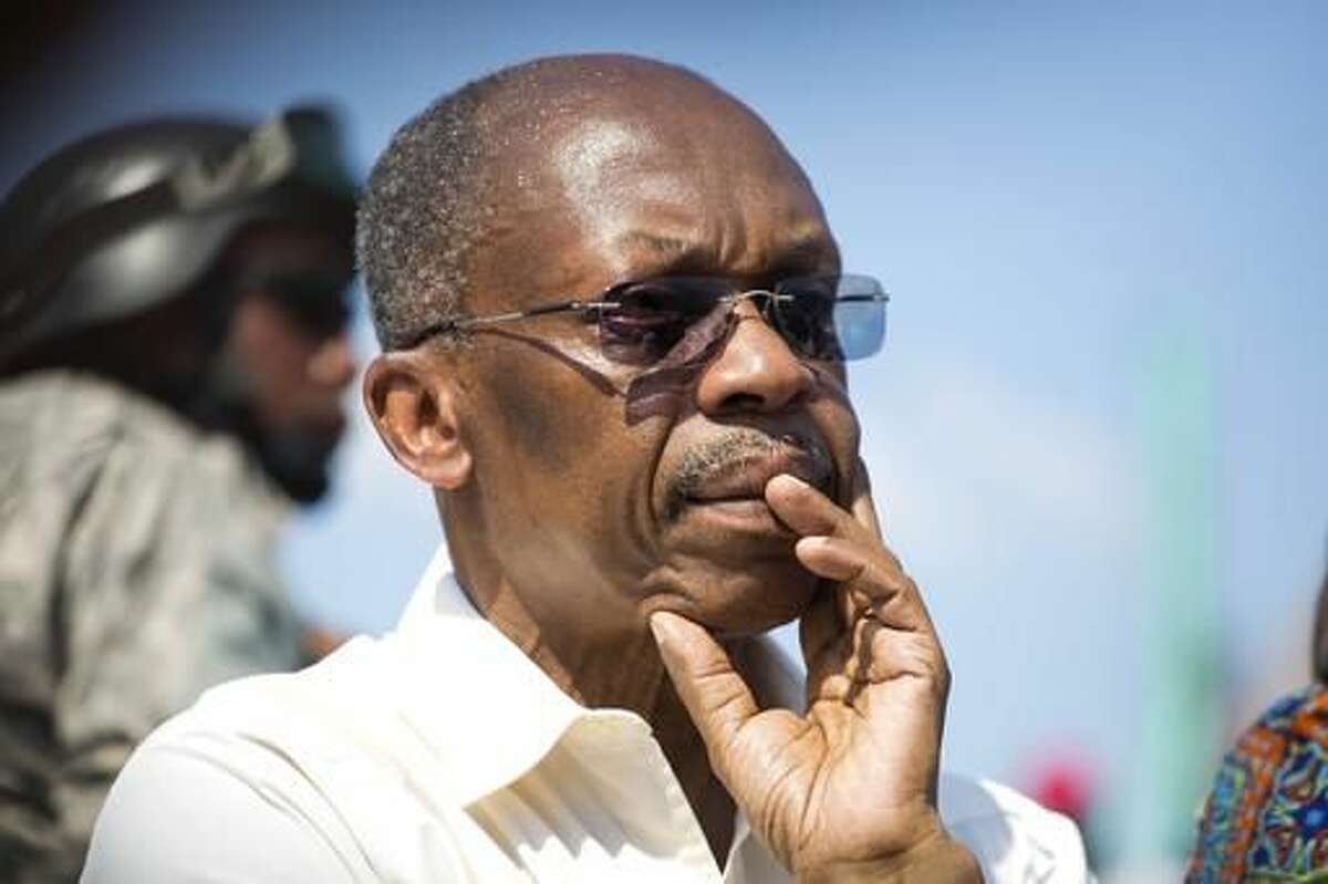 In this Sept. 21, 2016 photo, Haiti's former President Jean-Bertrand Aristide looks on after speaking to supporters at a campaign event for presidential candidate Maryse Narcisse of the Fanmi Lavalas political party, in Port-au-Prince, Haiti. Although Aristide said he wouldn't focus on politics after he returned from exile in 2011, the twice-elected, twice-ousted leader has been campaigning for Narcisse, the presidential candidate for his Fanmi Lavalas party. (AP Photo/Dieu Nalio Chery)