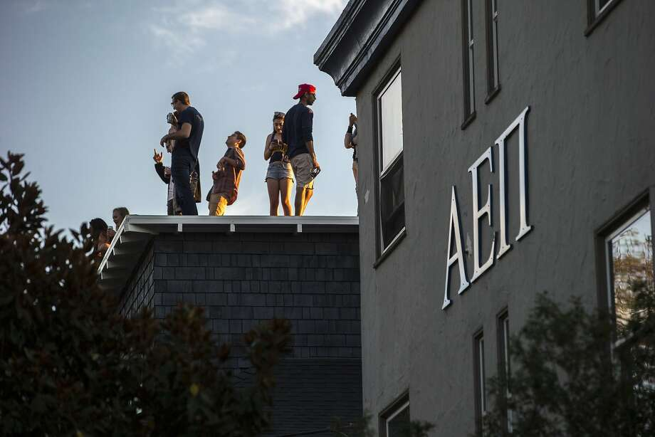 People party on a rooftop next to Alpha Epsilon Pi, which also hosted a social event on Friday, Oct. 21, 2016 in Berkeley, Calif. Following reports of two sexual assaults last week at off-campus frat functions, fraternities and sororities at UC Berkeley were temporarily banned by the university's Interfraternity Council. Photo: Santiago Mejia, The Chronicle