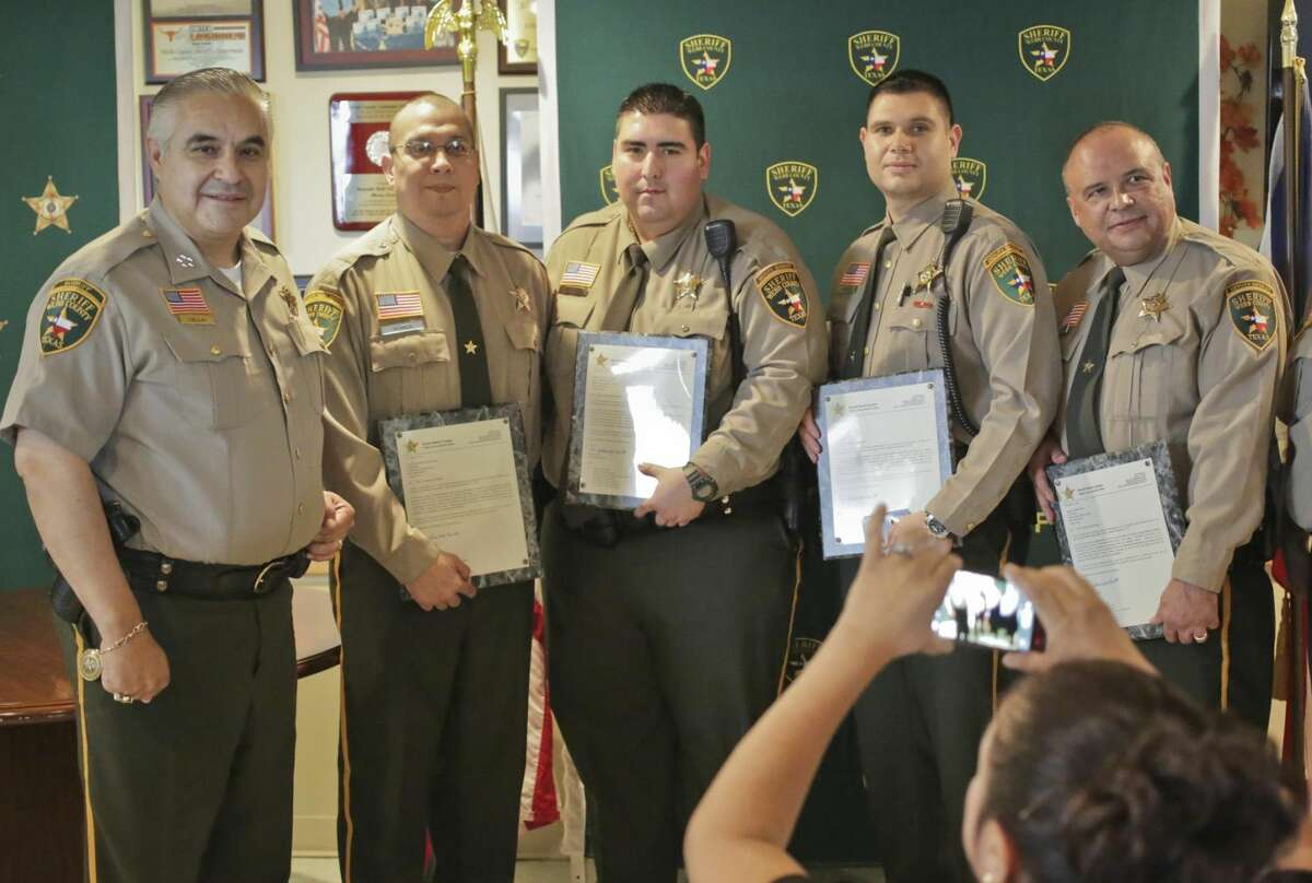 Climbing the ranks Sheriff Martin Cuellar, left, poses with four newly promoted officers - Ramiro Flores, Antonio Tamez, Jesse Gonzalez and Abraham Garza - during a ceremony Wednesday afternoon at the Webb County Sheriff's Office. (Photo by Victor Strife/Laredo Morning Times)