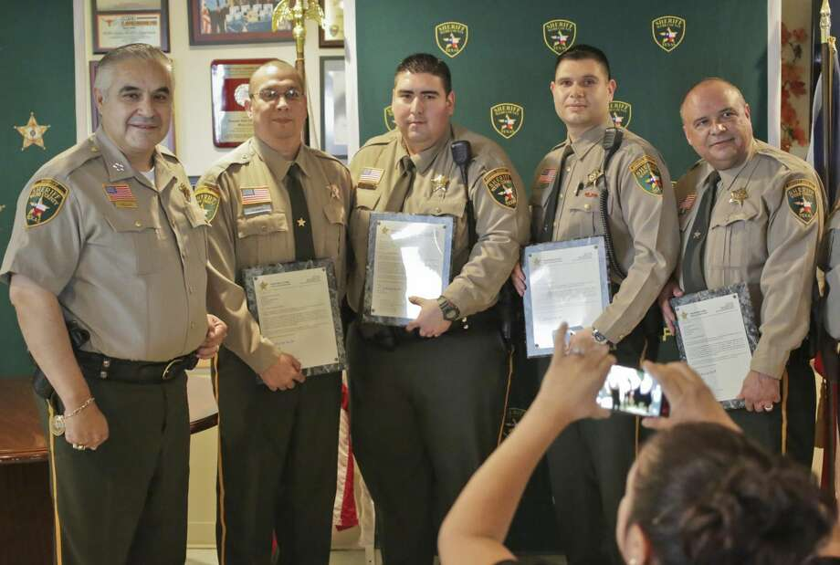 Climbing the ranksSheriff Martin Cuellar, left, poses with four newly promoted officers — Ramiro Flores, Antonio Tamez, Jesse Gonzalez and Abraham Garza — during a ceremony Wednesday afternoon at the Webb County Sheriff's Office. (Photo by Victor Strife/Laredo Morning Times)