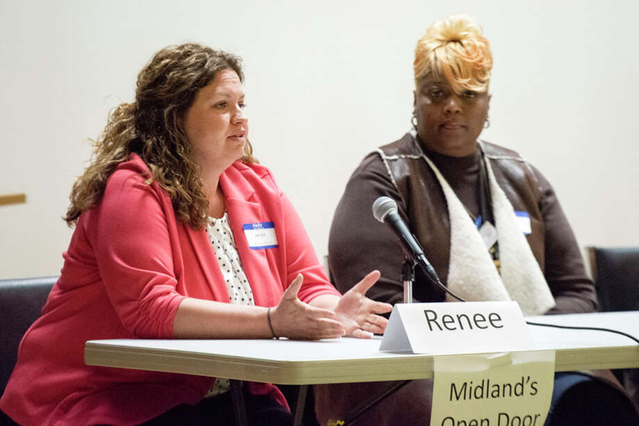 DANIELLE MCGREW TENBUSCH | for the Daily News Renee Pettinger, Executive Director of Midland's Open Door, discusses some of the barriers preventing some people from finding stable housing during a panel discussion about homelessness on Thursday at the Grace A. Dow Library Auditorium. Eight panel participants from local agencies answered questions and discussed how their organizations are impacting the community. There was also a screening of the documentary Storied Streets.