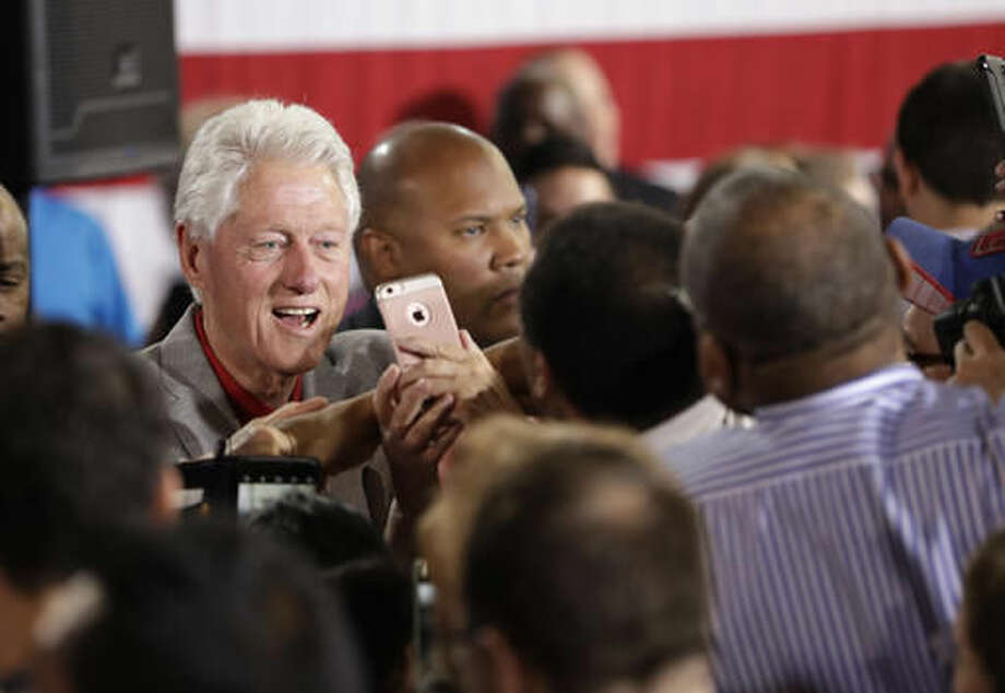 Former President Bill Clinton meets with supporters while campaigning for his wife, Democratic presidential candidate Hillary Clinton, Wednesday, Sept. 14, 2016, in North Las Vegas, Nev. (AP Photo/John Locher)