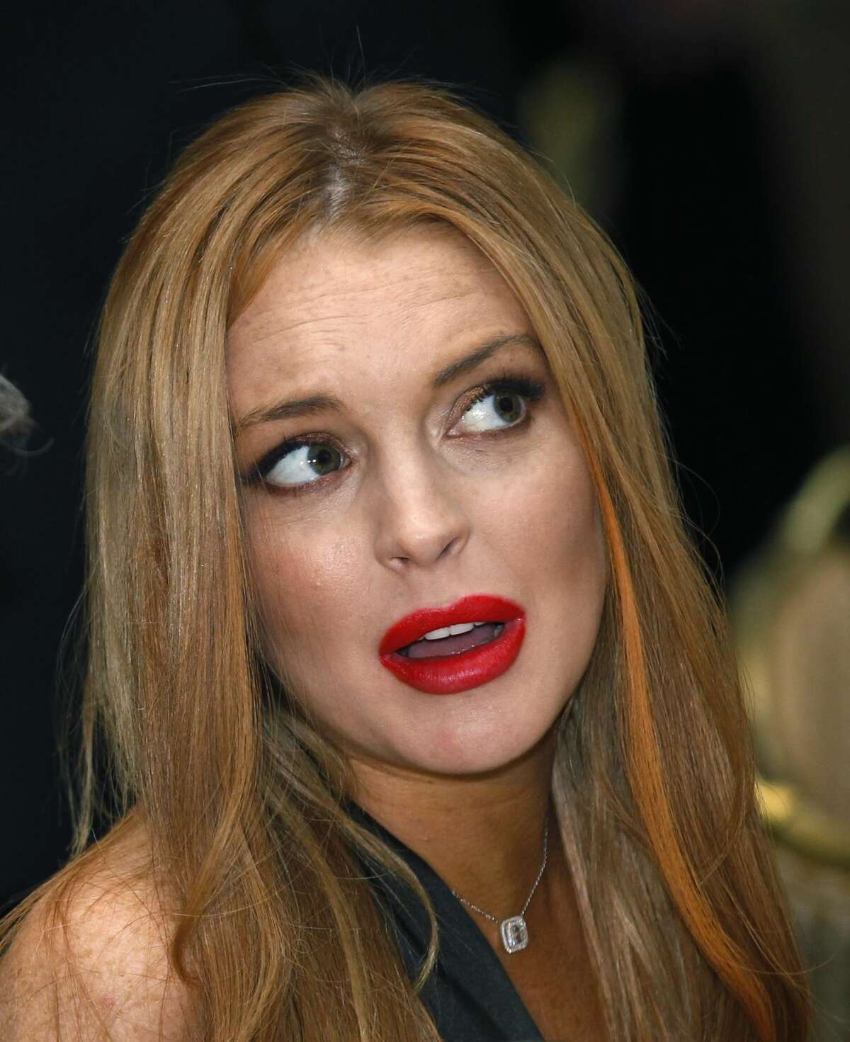 In a Saturday, April 28, 2012 file photo, Lindsay Lohan attends the White House Correspondents' Association Dinner headlined by late-night comic Jimmy Kimmel, in Washington. Police say Lohan was arrested at 2:25 a.m. Wednesday, Sept. 19, 2012, in New York City on charges that she clipped a pedestrian with her car and did not stop. Police say no alcohol was involved. (AP Photo/Haraz N. Ghanbari, File)