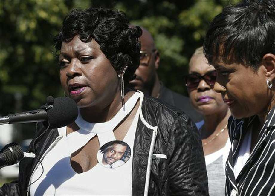 FILE - In this July 12, 2016 file photo, TV Judge Glenda Hatchett, right, listens as Valerie Castile, the mother of Philando Castile, takes questions during a news conference on the State Capitol grounds in St. Paul, Minn. Hatchett is representing the Castile family in the shooting death by police of Philando Castile last week in Falcon Heights, Minn. after a traffic stop by St. Anthony police. A photo button of Philando is shown on Valerie Castile's dress. Recent shootings by police raise a fundamental question: In the moments after officers shoot someone, how soon can medical aid be given? (AP Photo/Jim Mone, File)