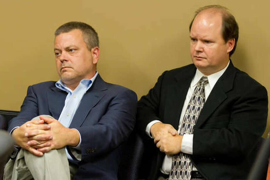 FILE - In this Oct. 23, 2012, file photo, Republican donor Andy Miller, left, and brother Tracy Miller listen to proceedings at a meeting of the Tennessee Registry of Election Finance in Nashville, Tenn. The Millers on Sept. 13, 2016, agreed to pay $7.8 million to settle allegations of defrauding a federal military health care program (AP Photo/Erik Schelzig, File)