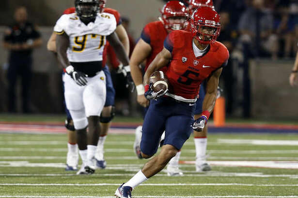 Arizona wide receiver Trey Griffey (5) runs after the catch against Grambling State during the first half of an NCAA college football game, Saturday, Sept. 10, 2016, in Tucson, Ariz. (AP Photo/Rick Scuteri)