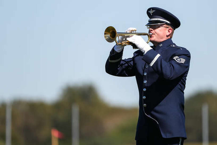 Staff Sgt. Daniel Thrower, of the USAF Heartland of America Band, performs the song Taps on his trumpet as the brand-new Omaha National Cemetery holds its first burials as four veterans are buried with full honors during a single ceremony in Omaha, Neb., Tuesday, Sept. 27, 2016. The new 236-acre cemetery will serve the burial needs of more than 112,000 veterans. (Brendan Sullivan /Omaha World-Herald via AP)