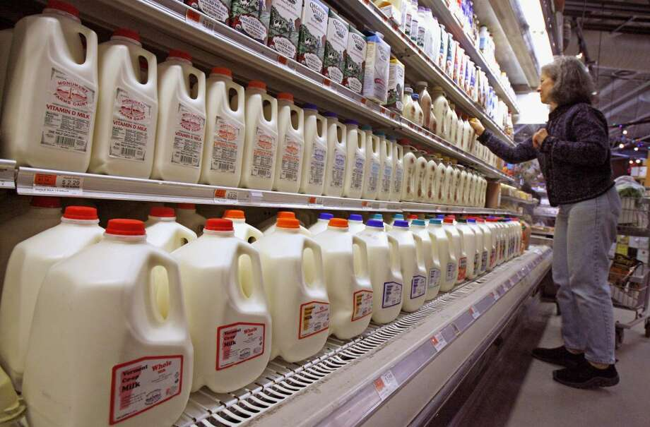 This Feb. 11, 2009 file photo shows a shopper looking over the milk aisle at the Hunger Mountain Co-op in Montpelier, Vt. (AP Photo/Toby Talbot, File)