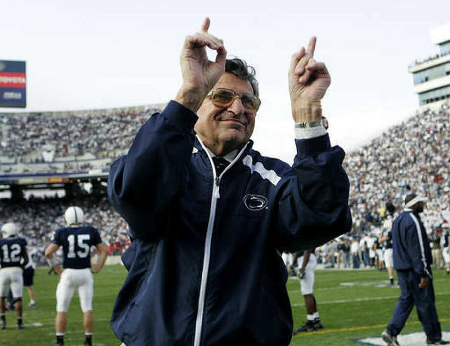 FILE - In this Nov. 5, 2005, file photo, Penn State football coach Joe Paterno acknowledges the crowd during warm-ups before an NCAA college football game against Wisconsin in State College, Pa. As Penn State's athletic department finalizes details for how to honor the 50th anniversary of Joe Paterno's first win, hundreds of the late coach's former players were on their way to town to attend a private reunion planned for Friday at the school's baseball stadium. (AP Photo/Carolyn Kaster, File)