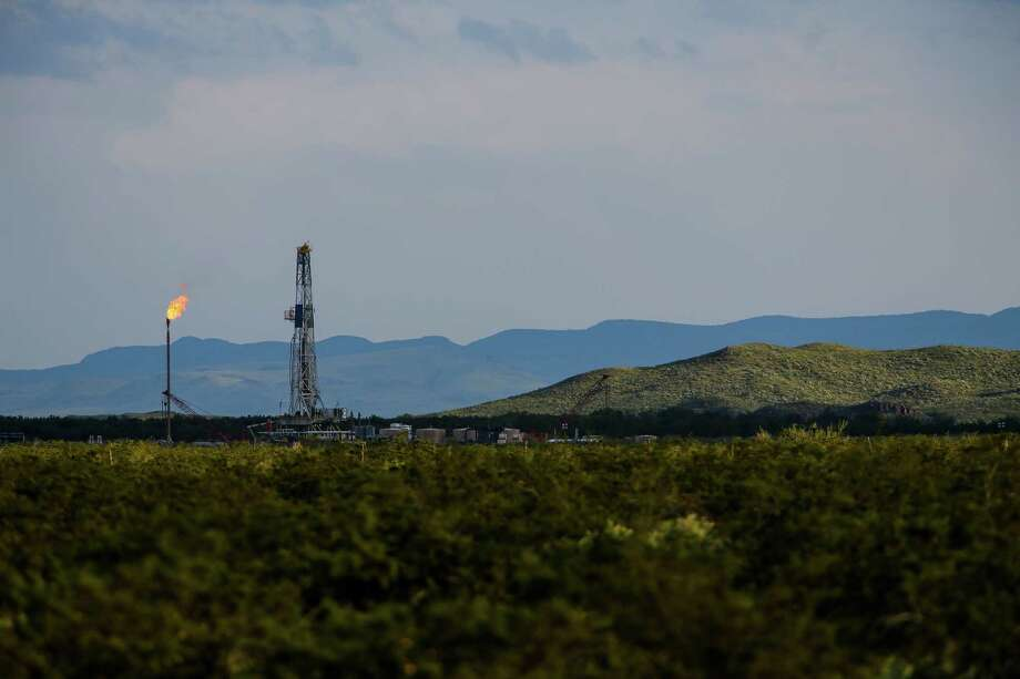This Apache Corp. drilling site is north of the Davis Mountains in the Balmorhea area. Photo: Michael Ciaglo, Staff / © 2016  Houston Chronicle