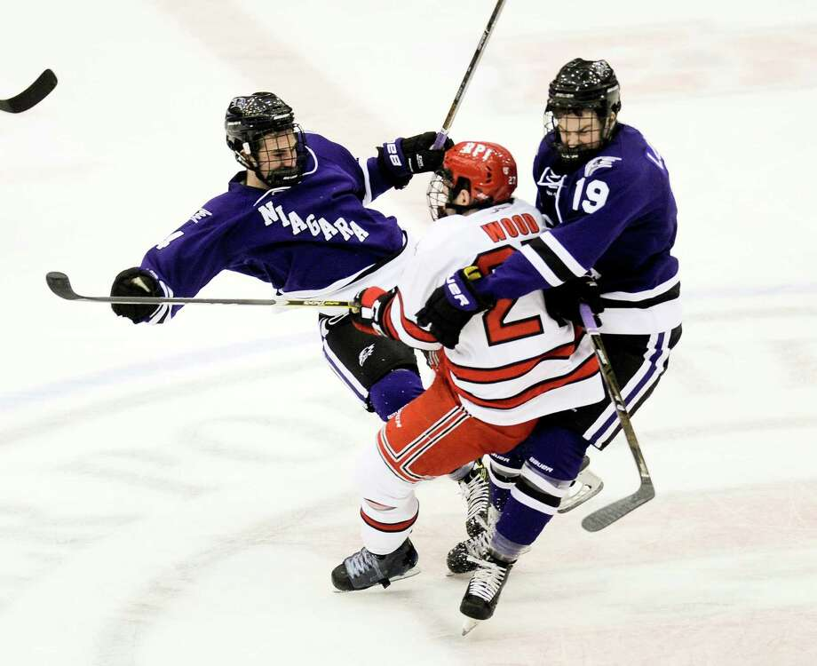 Niagara's Johnny Curran (14) and Tanner Lomsnes (19) collide with  Rensselaer Polytechnic Institute's  Riley Bourbonnais (14) during the first period of an NCCA hockey game in Troy, N.Y., Friday, Oct. 21, 2016. (Hans Pennink / Special to the Times Union)      ORG XMIT: HP101 Photo: Hans Pennink / Hans Pennink