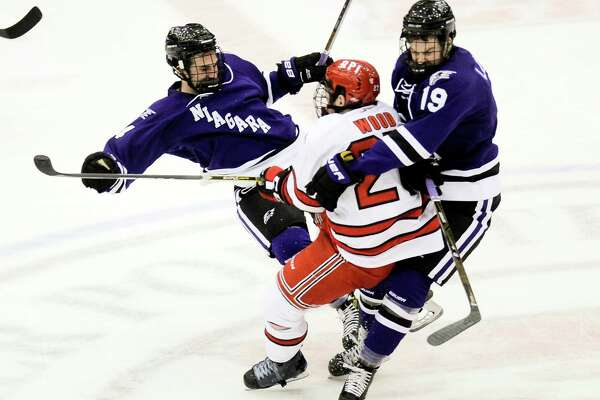 Niagara's Johnny Curran (14) and Tanner Lomsnes (19) collide with  Rensselaer Polytechnic Institute's  Riley Bourbonnais (14) during the first period of an NCCA hockey game in Troy, N.Y., Friday, Oct. 21, 2016. (Hans Pennink / Special to the Times Union)      ORG XMIT: HP101