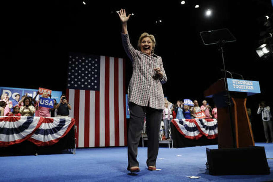 Democratic presidential candidate Hillary Clinton waves during a campaign stop in Fort Pierce, Fla., Friday, Sept. 30, 2016. (AP Photo/Matt Rourke)