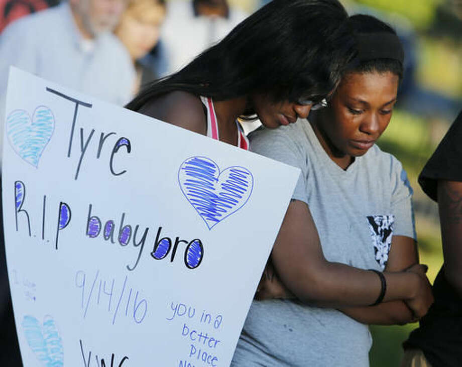 Members of Tyre King's family console each other during a vigil for 13-year-old Tyre King Thursday, Sept. 15, 2016, in Columbus, Ohio. King was shot and killed by Columbus police Wednesday evening. (AP Photo/Jay LaPrete)