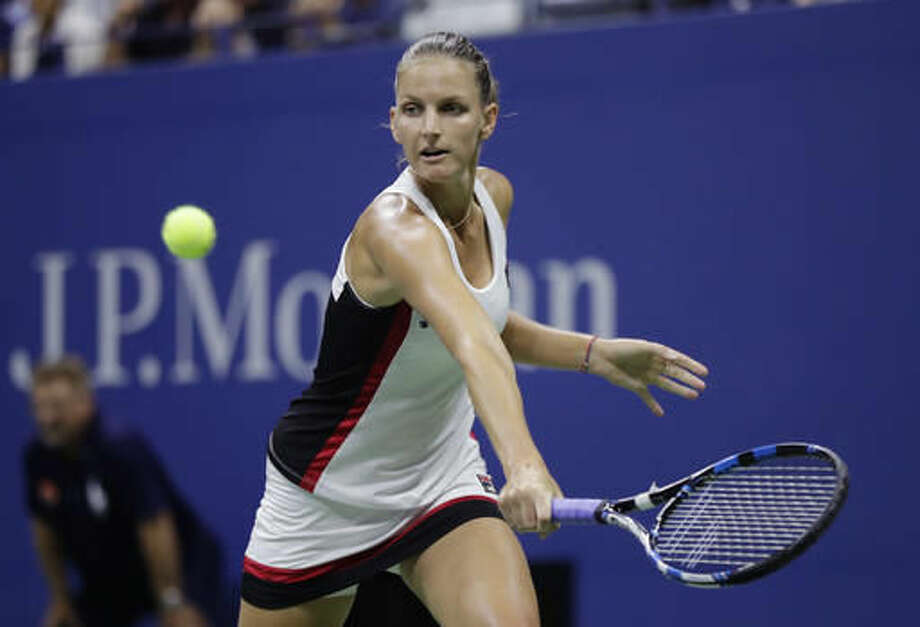 Karolina Pliskova, of the Czech Republic, returns a shot to Serena Williams during the semifinals of the U.S. Open tennis tournament, Thursday, Sept. 8, 2016, in New York. (AP Photo/Julio Cortez)