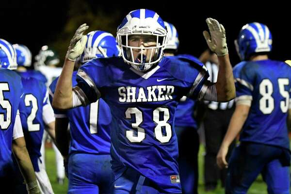 Shaker's Will Fazzone, center, gestures for the fans to make noise during their Class AA quarterfinal football game against Shenendehowa, on Friday, Oct. 21, 2016, at Shaker High in Latham, N.Y. (Cindy Schultz / Times Union)