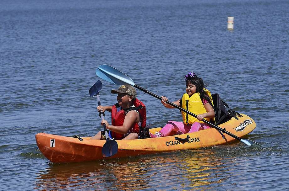 Eco Camp participants Juan and Dulce Hurtado paddle their way back to shore after kayaking at Lake Casa Blanca International State Park Thursday morning. The camp is hosted by the Rio Grande International Study Center. (Photo by Cuate Santos/Laredo Morning Times) Photo: Cuate Santos/Laredo Morning Times