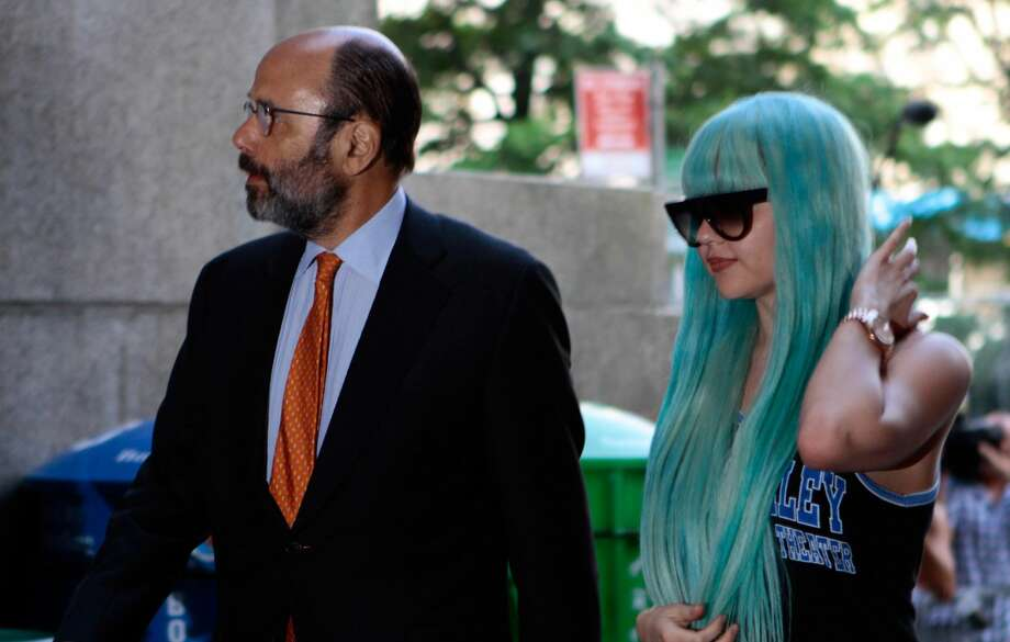 In a Tuesday, July 9, 2013 file photo, Amanda Bynes, accompanied by attorney Gerald Shargel, arrives for a court appearance in New York on allegations that she chucked a marijuana bong out the window of her 36th-floor Manhattan apartment. (AP Photo/Bethan McKernan, File)