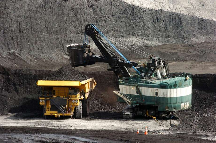In this April 4, 2013 file photo, a mechanized shovel loads coal onto a haul truck at the Cloud Peak Energy's Spring Creek mine near Decker, Mont. The coal industry, which was hoping for a rebound in 2013 after struggling to stay competitive in recent years, is back on the defensive after President Barack Obama renewed calls for carbon dioxide reductions from new and existing power plants. (AP Photo/Matthew Brown,file)