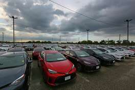 New Toyotas are lined up awaiting sale in the back lot at the Sterling McCall Toyota dealership on the Southwest Freeway, Thursday, Oct. 20, 2016, in Houston. ( Mark Mulligan / Houston Chronicle )