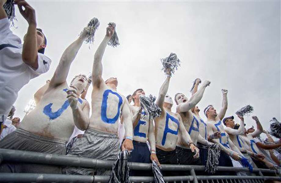 "Students with ""JOE PATERNO"" painted across their chests cheer during an NCAA college football game between Penn State and Temple, Saturday, Sept. 17, 2016, at State College, Pa. Penn State defeated Temple 34-27, and celebrated the 50th anniversary of former head coach Joe Paterno's first game by honoring members of the 1966 football team and showing video tributes on the scoreboard. (Abby Drey/Centre Daily Times via AP)"