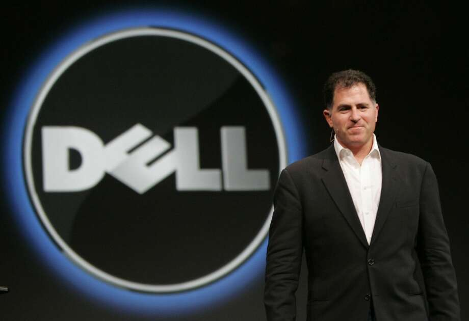 In this Wednesday, Nov. 14, 2007 file photo, Dell CEO Michael Dell smiles at Oracle Open World conference in San Francisco. (AP Photo/Paul Sakuma, File)