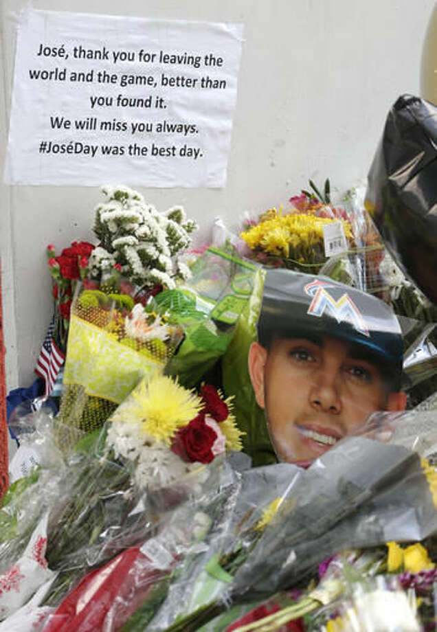 Flowers and mementos lies around a memorial for Miami Marlins pitcher Jose Fernandez outside Marlins Park stadium, Wednesday, Sept. 28, 2016, in Miami. Fernandez was killed in a weekend boat crash along with two friends. (AP Photo/Wilfredo Lee)