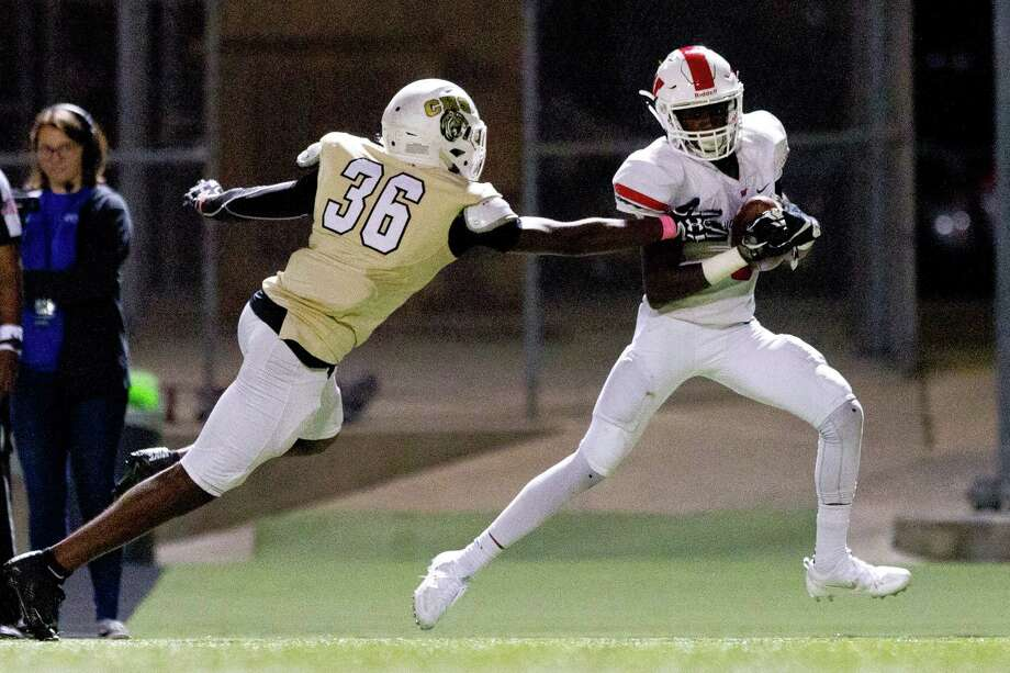 The Woodlands wide receiver Kesean Carter (6) gets past Conroe defensive back Quentin Brown for a 29-yard touchdown reception during the third quarter of a District 12-6A high school football game at Buddy Moorhead Stadium Friday in Conroe. Photo: Jason Fochtman, Staff Photographer / Houston Chronicle