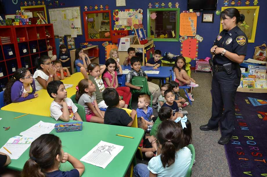 Laredo police officer Laura Montemayor, a member of the department's Crime Prevention/Community Relations Unit, visited with the children at Lil' Hearts Day Care Wednesday morning. The children learned safety tips from the officer. (Photo by Cuate Santos/Laredo Morning Times)