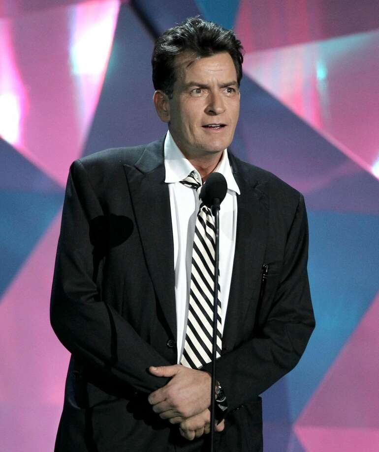 "This June 3, 2012 photo shows actor Charlie Sheen at the MTV Movie Awards in Los Angeles. In an interview Tuesday, July 17, 2012 on Ryan Seacrest's radio show, Sheen said ""American Idol"" producer Nigel Lythgoe publicly threw his name out there as a possible judge and the idea peaked his interest. (Photo by Matt Sayles/Invision/AP, file)"