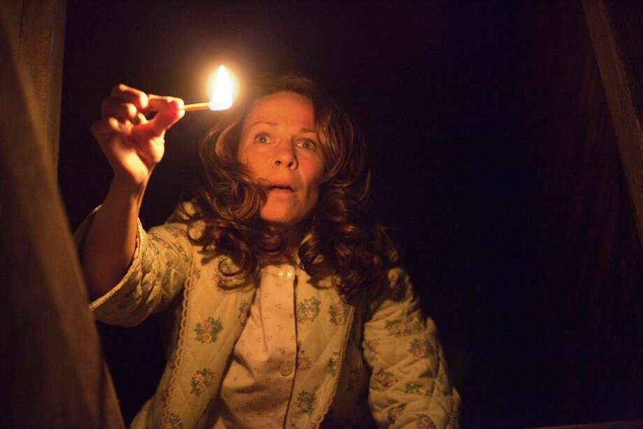 "Lili Taylor, who portrays Carolyn Perron in ""The Conjuring,"" is undecided as to whether she believes in ghosts. The movie hit the top spot at the weekend box office with $41.5 million in ticket sales. Photo by Michael Tackett/New Line Cinema/Warner Bros. Pictures"