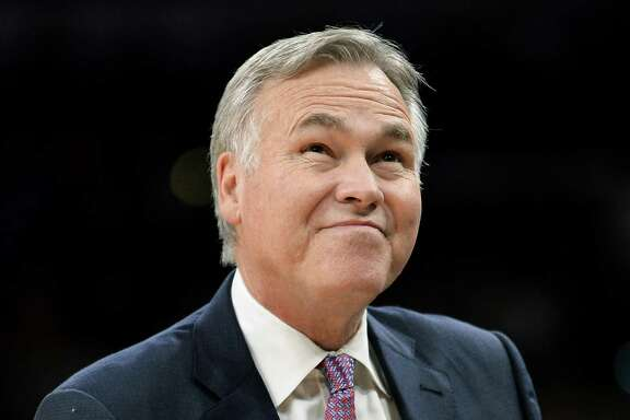 Houston Rockets coach Mike D'Antoni walks to the bench during the first half of the team's preseason NBA basketball game against the San Antonio Spurs, Friday, Oct. 21, 2016, in San Antonio. San Antonio won 114-99. (AP Photo/Darren Abate)