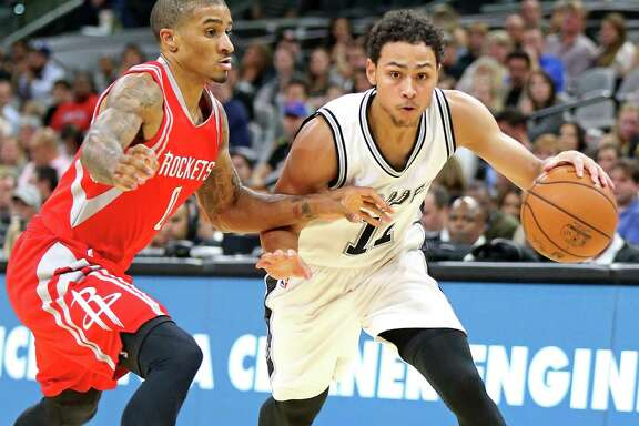 San Antonio Spurs' Bryn Forbes looks for room around Houston RocketsÕ Gary Payton II during second half action of their preseason game held Friday Oct. 21, 2016 at the AT&T Center. The Spurs won 114-99.