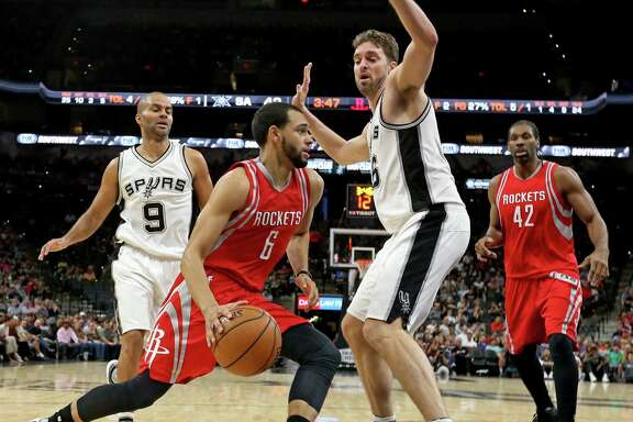 Houston RocketsÕ Tyler Ennis looks for room around San Antonio Spurs' Pau Gasol as San Antonio Spurs' Tony Parker and Houston RocketsÕ Nene look on during first half action of their preseason game held Friday Oct. 21, 2016 at the AT&T Center.