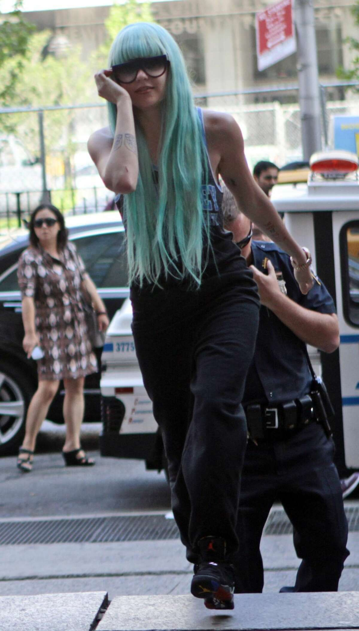 Amanda Bynes arrives for a court appearance, in New York, Tuesday, July 9, 2013. The 27-year-old actress is charged with reckless endangerment and attempted tampering with physical evidence. Bynes was arrested in May after building officials called police to complain she was smoking pot in the lobby. Officers went to her apartment where they say they saw a bong sitting on the kitchen counter. Prosecutors say she tossed the bong out the window in front of the officers. (AP Photo/Bethan McKernan)