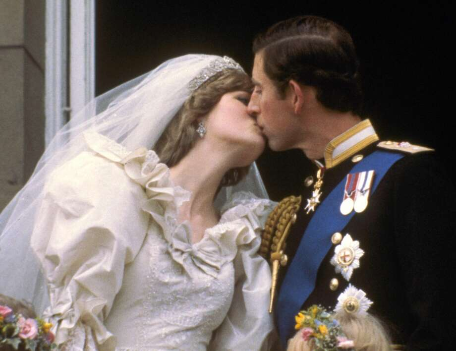 In this July 29, 1981 file photo, Britain's Prince Charles kisses his bride, the former Diana Spencer, on the balcony of Buckingham Palace in London, after their wedding. (AP Photo, file)