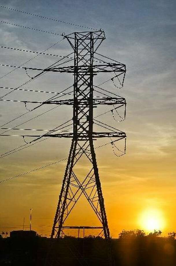 An electrical tower is silhouetted against the setting sun outside of Mall Del Norte. AEP announced they will conduct a planned electrical outage early Wednesday morning. (File photo by: Danny Zaragoza