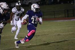 Montgomery's Waverly Hampton (25) returns the ball a game against College Park on Friday at Bears Stadium in Montgomery